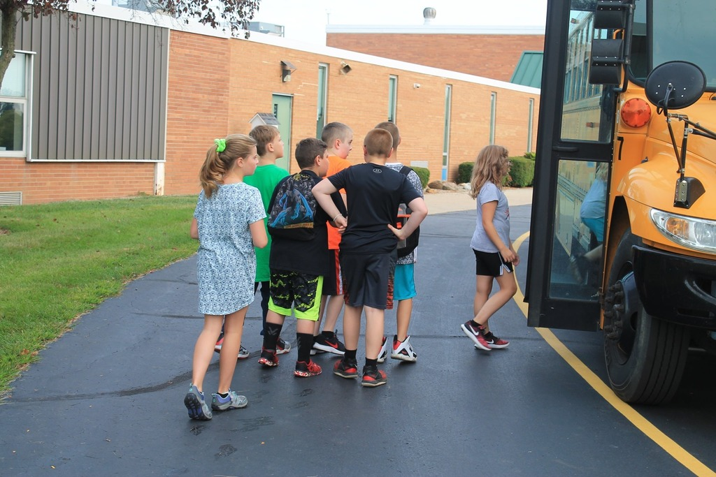students loading on bus